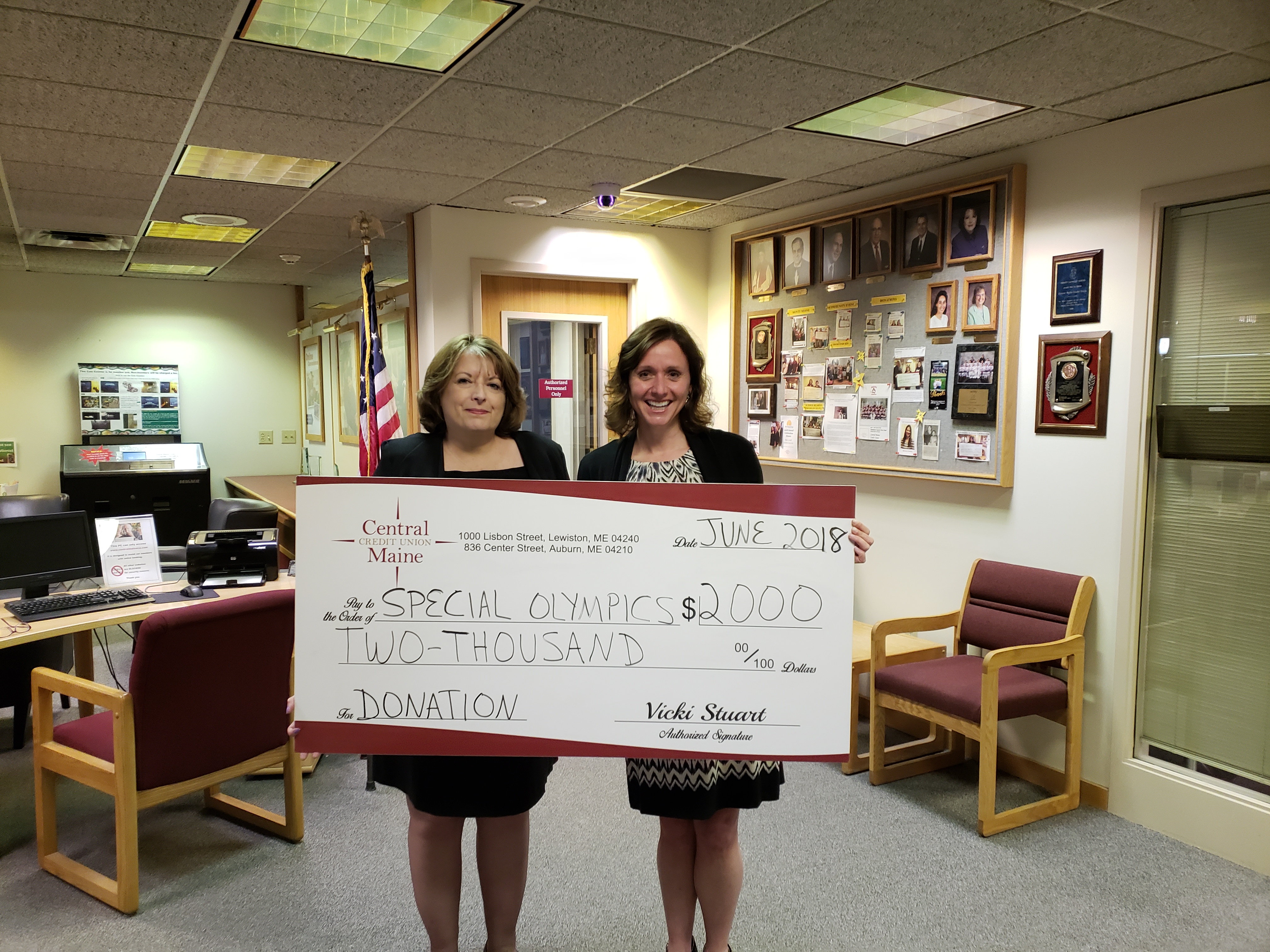 Central Maine Credit Union donated $2,000 to Maine's Special Olympics. Kim Daigle, Board member for Maine's Special Olympics and CEO of Insurance Trust happily accepts the check from Vicki Stuart